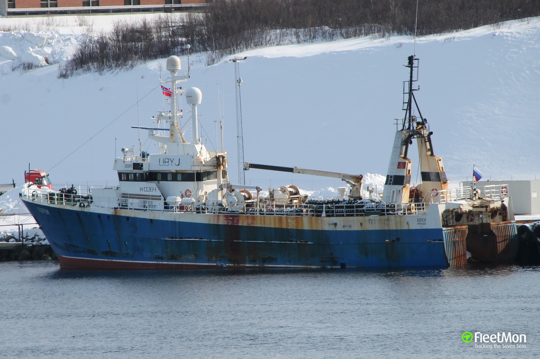 Disabled Russian trawler under tow of Norway CG ship