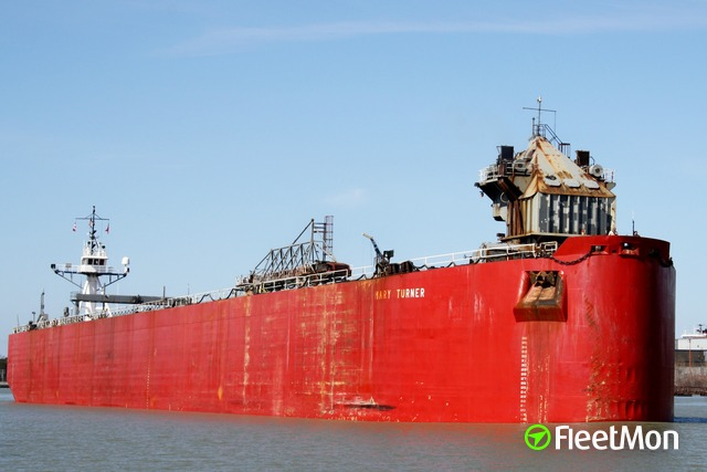 Tug with barge aground, Great Lakes