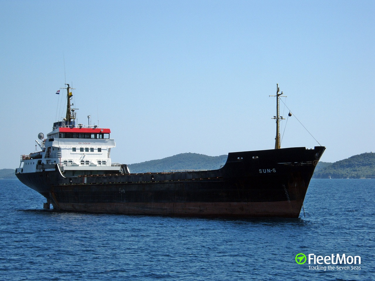 Cargo ship damaged after contacting pier, Crete